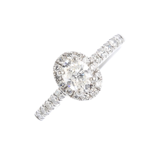 451 - A platinum diamond single-stone ring. The oval-shape diamond, weighing 0.56ct, with brilliant-cut di...