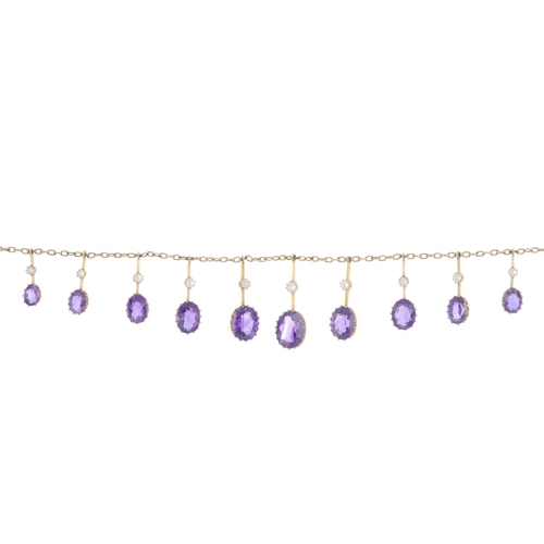 457 - An early 20th century 9ct gold amethyst and split pearl necklace. The graduated oval-shape amethyst ...
