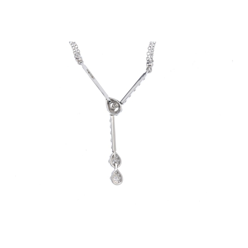 46 - MAPPIN & WEBB - an 18ct gold diamond necklace. The brilliant-cut diamond lariat motif drop, with int...
