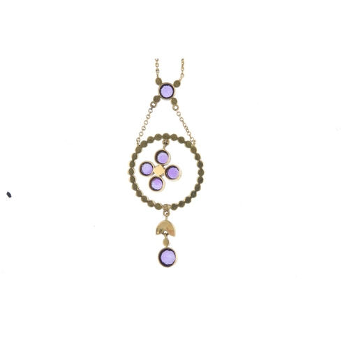 460 - An early 20th century 15ct gold amethyst and split pearl necklace. The circular-shape amethyst and s...