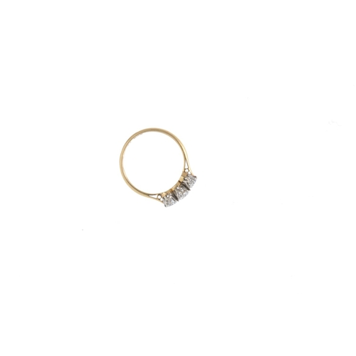 462 - A mid 20th century gold diamond three-stone ring. The circular-cut diamond line, with tapered should...