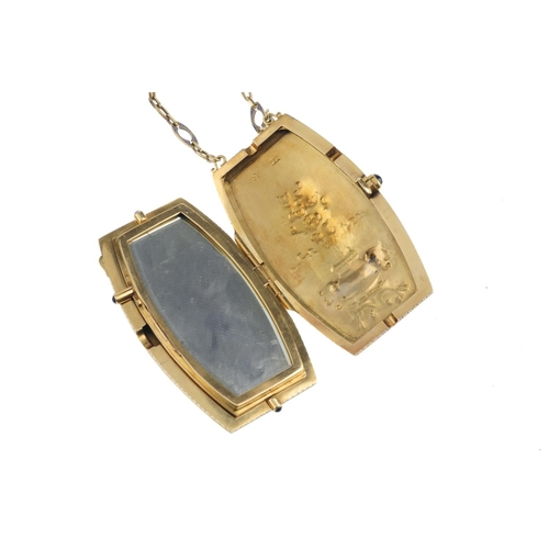 463 - An early 20th century 18ct gold and enamel compact. Of curved rectangular outline, the embossed wing...