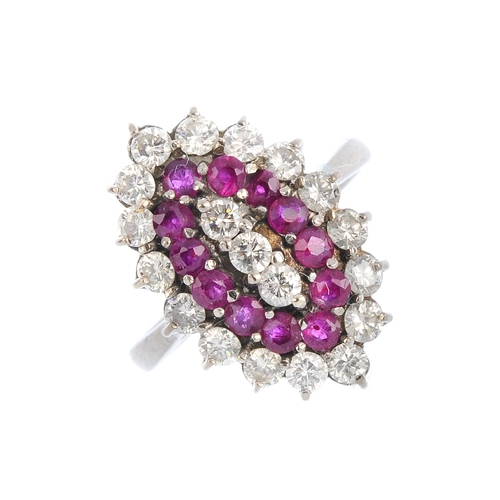 464 - A ruby and diamond cluster ring. Of marquise-shape outline, the brilliant-cut diamond line, with cir...