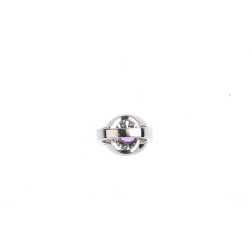 467 - A Burmese sapphire and diamond ring. The oval-shape pink sapphire, weighing 1.21cts, with vari-cut d...
