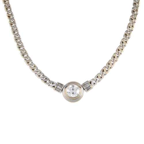 468 - A diamond necklace. The circular-cut diamond collet, with tapered baguette-cut diamond panel sides a...