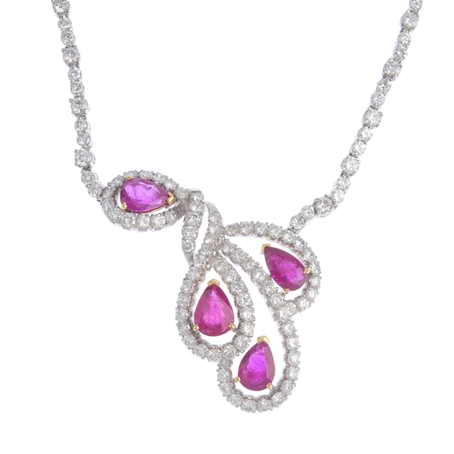 470 - A ruby and diamond necklace. Comprising four pear-shape rubies, within brilliant-cut diamond scrolli...