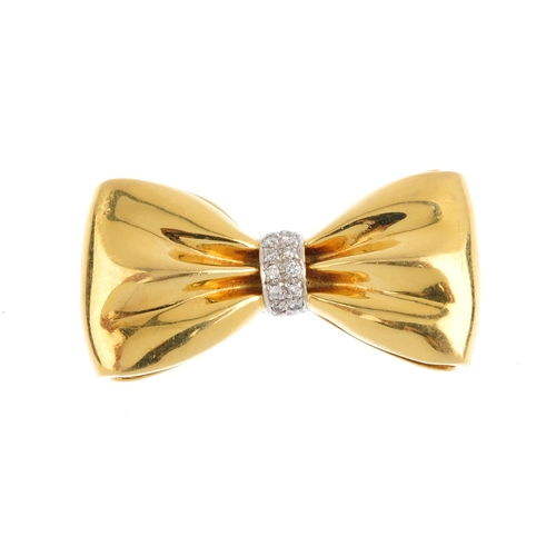 479 - WEMPE - a diamond brooch. Designed as a bow, gathered at a brilliant-cut diamond knot. Signed and nu...