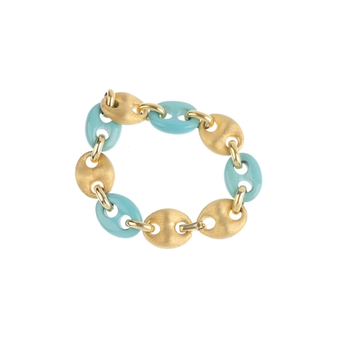 482 - A reconstituted turquoise bracelet. Designed as an alternating series of reconstituted turquoise and...