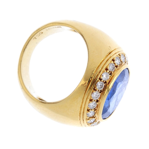 483 - A sapphire and diamond dress ring. The oval-shape sapphire collet, with brilliant-cut diamond surrou...