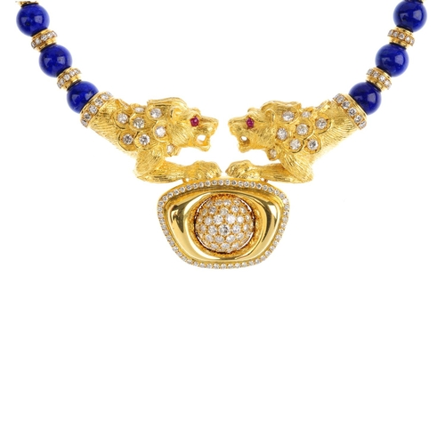 484 - A lapis lazuli and diamond necklace. The pave-set diamond dome and brilliant-cut diamond raised surr...