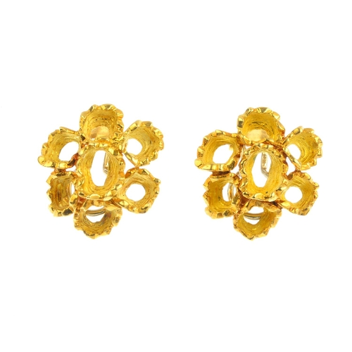 492 - A pair of 1970s 18ct gold earrings. Each designed as a textured, open oval, with similarly-designed ...