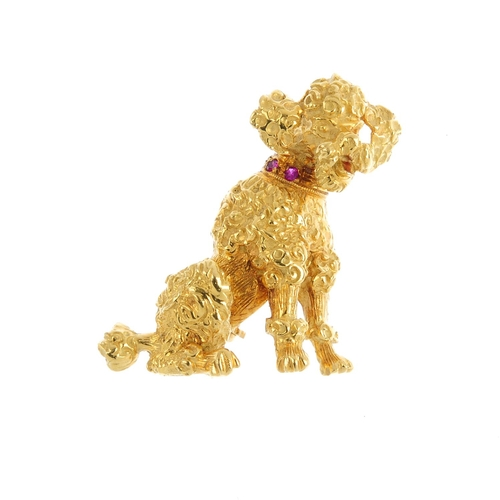 495 - A ruby poodle brooch. Designed as a textured poodle, with circular-shape ruby accent collar and red ...