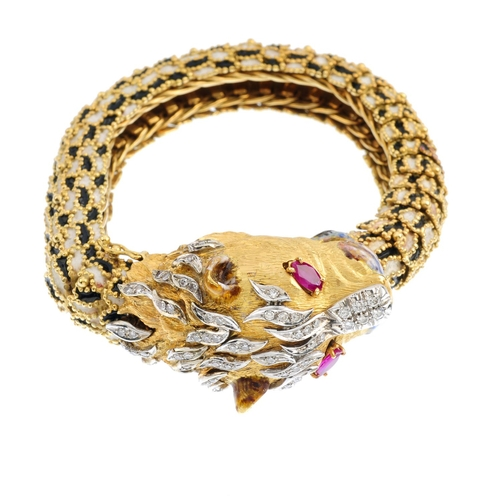 499 - A diamond and enamel tiger bracelet. The textured face, with enamel muzzle, ruby eyes and single-cut...