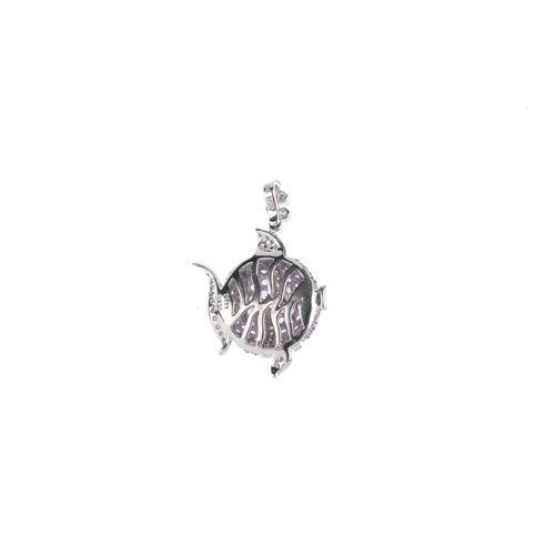 50 - A sapphire and diamond pendant. The circular-shape pink sapphire fish, with brilliant-cut diamond st...