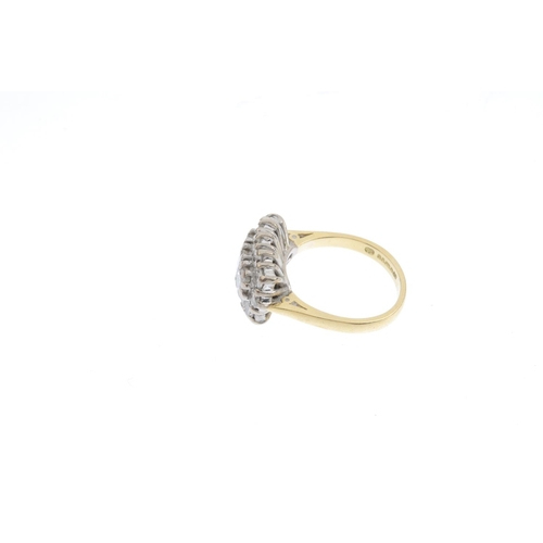 500 - An 18ct gold diamond dress ring. The square-shape diamond line, with brilliant-cut diamond surround....