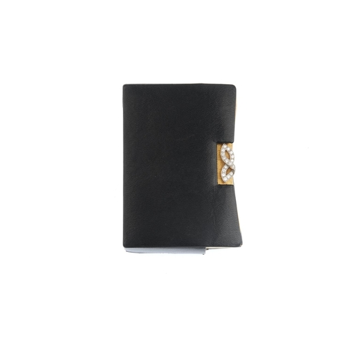 503 - CARTIER - a mid 20th century powder compact. The shaped rectangular case, with engine-turned geometr...