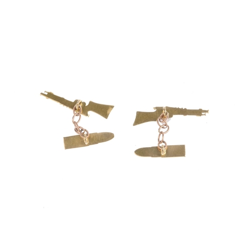 509 - A pair of cufflinks. Each designed as a rifle. with bullet reverse, to the trace-link connecting cha...