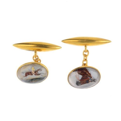 510 - A pair of reverse-carved intaglio cufflinks. Each designed as a rock crystal cabochon, carved and pa...