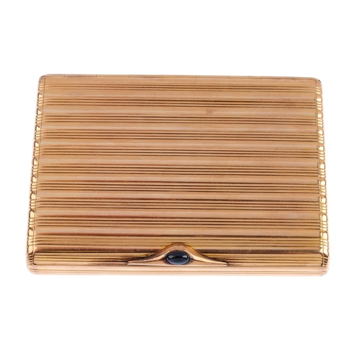 513 - An early 20th century Russian gold cigarette case. Of rectangular outline, the grooved case, with ro...