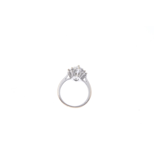 54 - A diamond cluster ring. The marquise-shape diamond, with brilliant-cut diamond surround and pear-sha...