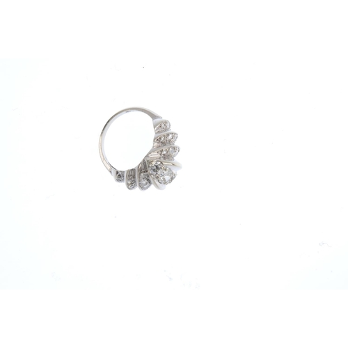 56 - A diamond dress ring. The circular-cut diamond curved marquise-shape line, with graduated vari-cut d...