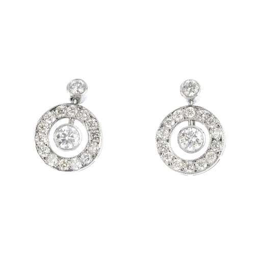 57 - A pair of diamond earrings. Each designed as a brilliant-cut diamond collet, suspended within a simi...