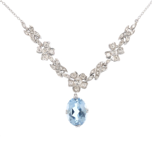 59 - An aquamarine and diamond necklace. The oval-shape aquamarine, suspended from a series of brilliant-...