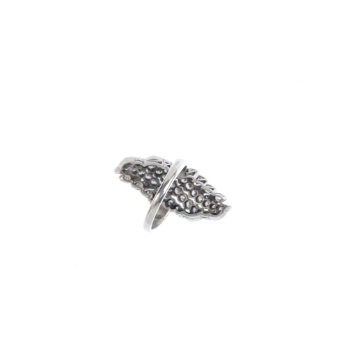 61 - A diamond dress ring. Designed as three brilliant-cut diamond undulating lines, with similarly-cut d...