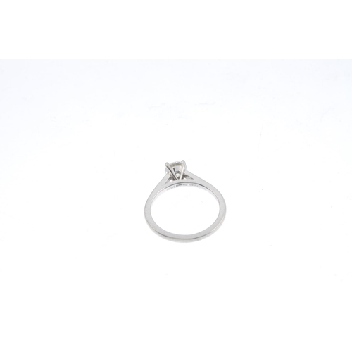 63 - DE BEERS - a platinum diamond single-stone ring. The brilliant-cut diamond, to the plain band. Signe...