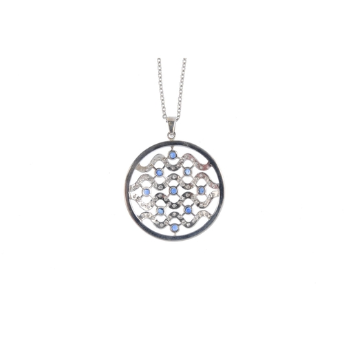 64 - A diamond and sapphire pendant. Of circular outline, the undulating brilliant-cut diamond lines, ato...