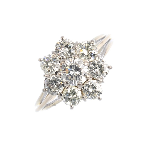 67 - A diamond cluster ring. The brilliant-cut diamond, with similarly-cut diamond surround. Estimated to...