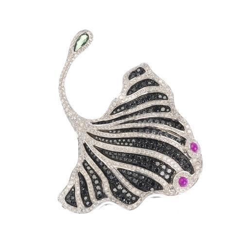 68 - A ruby, diamond and gem-set stingray brooch. The pave-set black-gem stingray, with brilliant-cut dia...