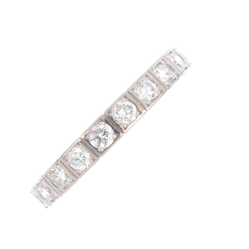 79 - CARTIER - an 18ct gold diamond 'Lanières' ring. Designed as a brilliant-cut diamond line, with groov...