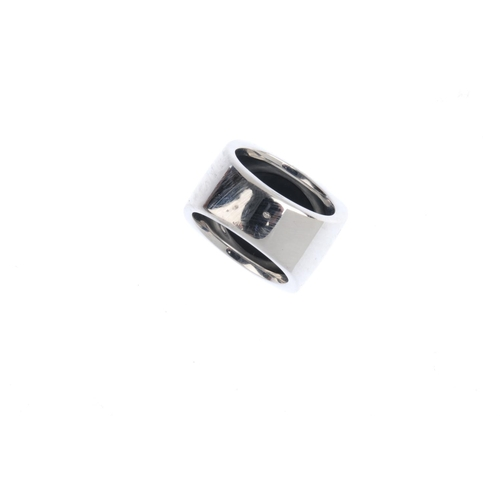 80 - CARTIER - a gentleman's onyx 'Baiser du Dragon' ring. Designed as a square-shape onyx panel, with ge...