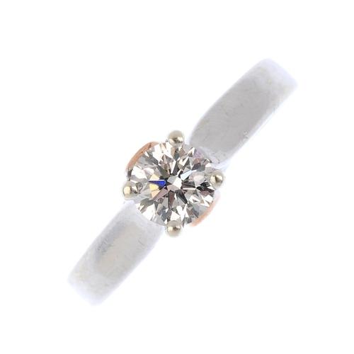 82 - CLOGAU - a 9ct gold diamond single-stone ring. The brilliant-cut diamond, with bi-colour foliate gal...