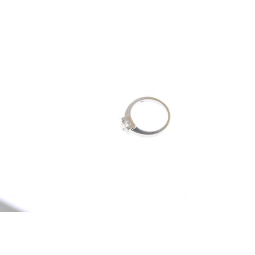 9 - A diamond single-stone ring. The old-cut diamond, tension-set to the plain band. Estimated diamond w...