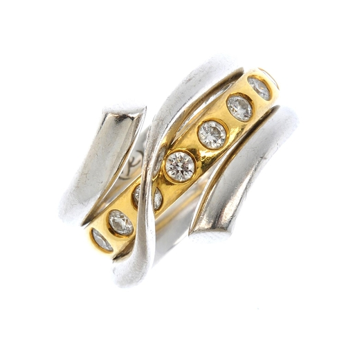 90 - GEORG JENSEN - two 18ct gold and diamond 'Magic' rings. The brilliant-cut diamond band ring, within ...
