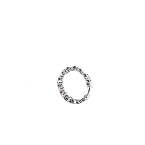 91 - GUCCI - a diamond flexible dress ring. Comprising three articulated lines of discs, with brilliant-c...