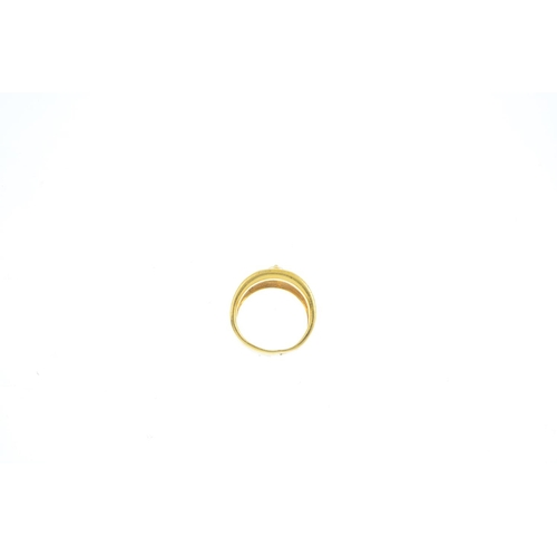 97 - VERSACE - an 18ct gold dress ring. The medusa head, with pierced Greek-key motif sides and tapered b...
