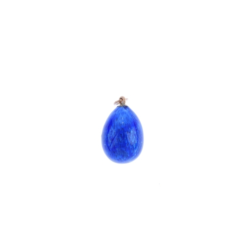 435 - An early 20th century Russian green enamel egg pendant. The blue enamel egg, suspended from an oval ...