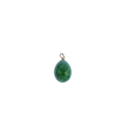 436 - An early 20th century Russian green enamel egg pendant. The green enamel egg, suspended from an oval...