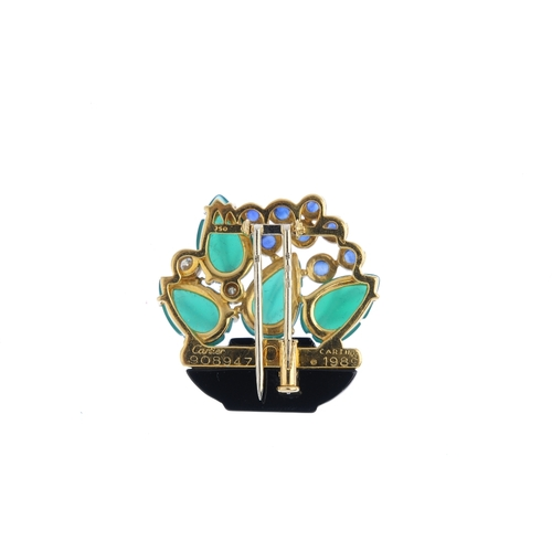 489 - CARTIER - a 1980s 18ct gold diamond and gem-set brooch. Designed as a carved onyx basket, with brill...