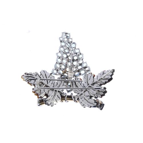 52 - A diamond and gem-set brooch. Designed to depict a circular-shape blue topaz and aquamarine bunch of...