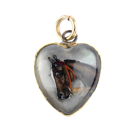 1 - A late Victorian gold reverse-carved intaglio pendant. The heart-shape rock crystal, reverse-carved ...