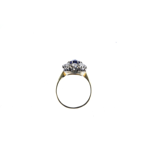 10 - An early 20th century gold sapphire and diamond cluster ring. The pear-shape sapphire, with old-cut ...