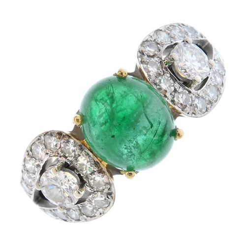 101 - An emerald and diamond dress ring. The oval emerald cabochon, with brilliant-cut diamond sides, each...