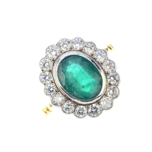 103 - An emerald and diamond cluster ring. The oval-shape emerald, with brilliant-cut diamond scalloped su...