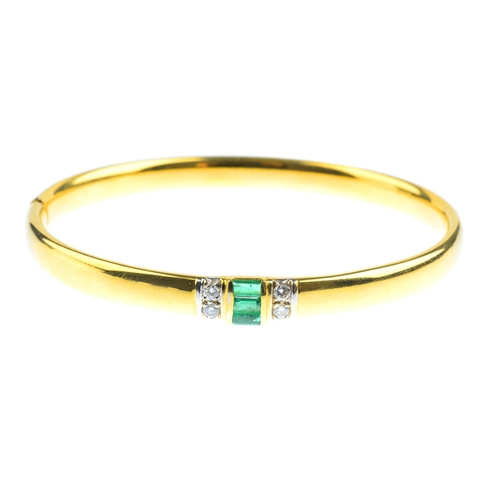 104 - An emerald and diamond bangle and pendant. The hinged bangle with rectangular-shape emerald line and...