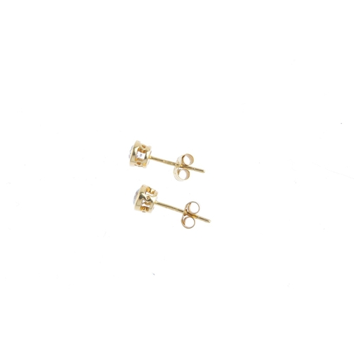 108 - A pair of 18ct gold brilliant-cut diamond stud earrings. Each within a collet mount. Total diamond w...
