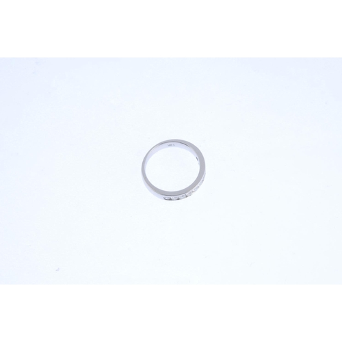 109 - A diamond half eternity ring. Designed as a brilliant-cut diamond line, inset to the plain band. Est...